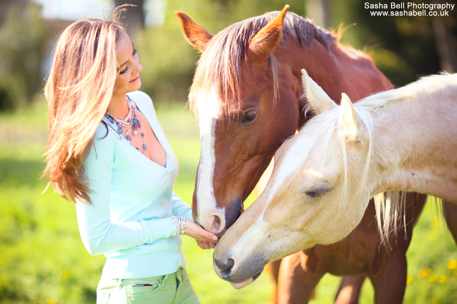 Girl with Chestnut and Palomino Horse